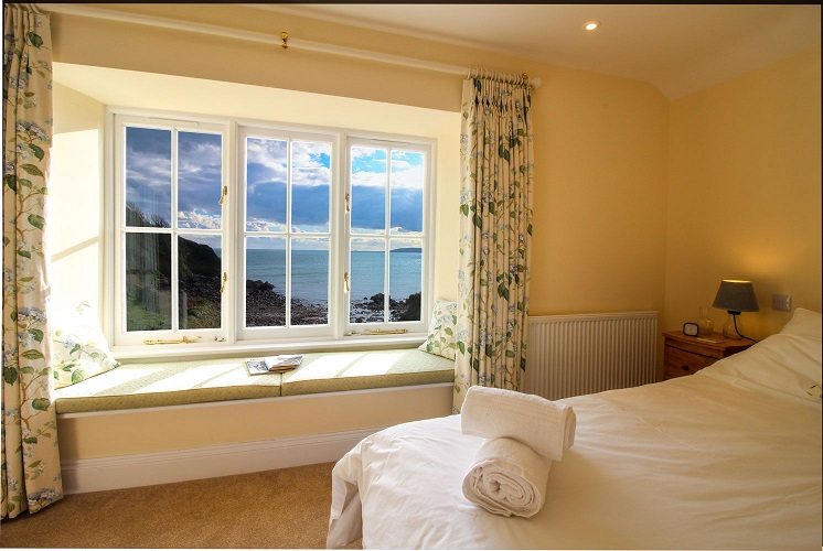 Hallane Mill in Cornwall bedroom with sea view