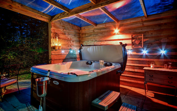 Private covered hot tub in Gipping Barn holiday cottage in Stonham Aspal Suffolk