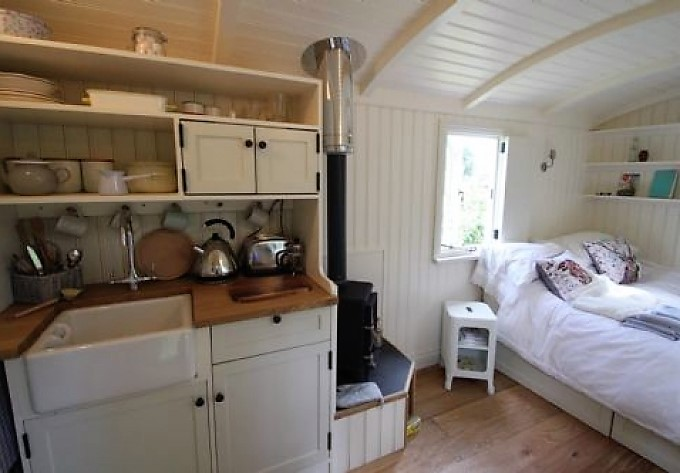 Interior of Shepherd's Hut in Longtown in Cumbria with log burner