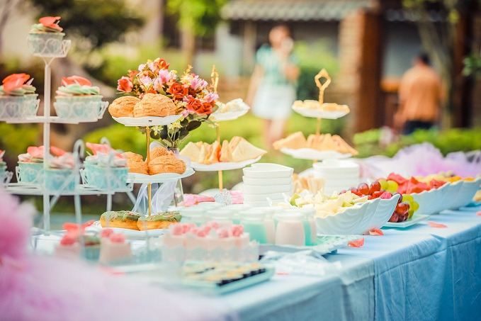 party food and cakes on a table